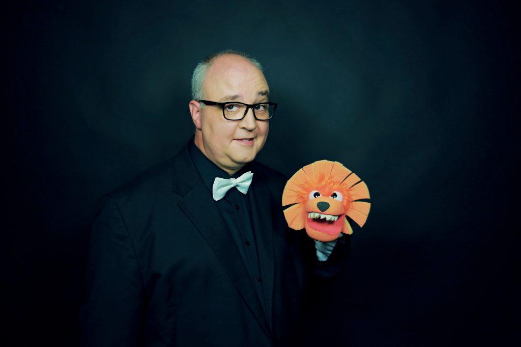 Portrait mit Loewe Norbert Lauter